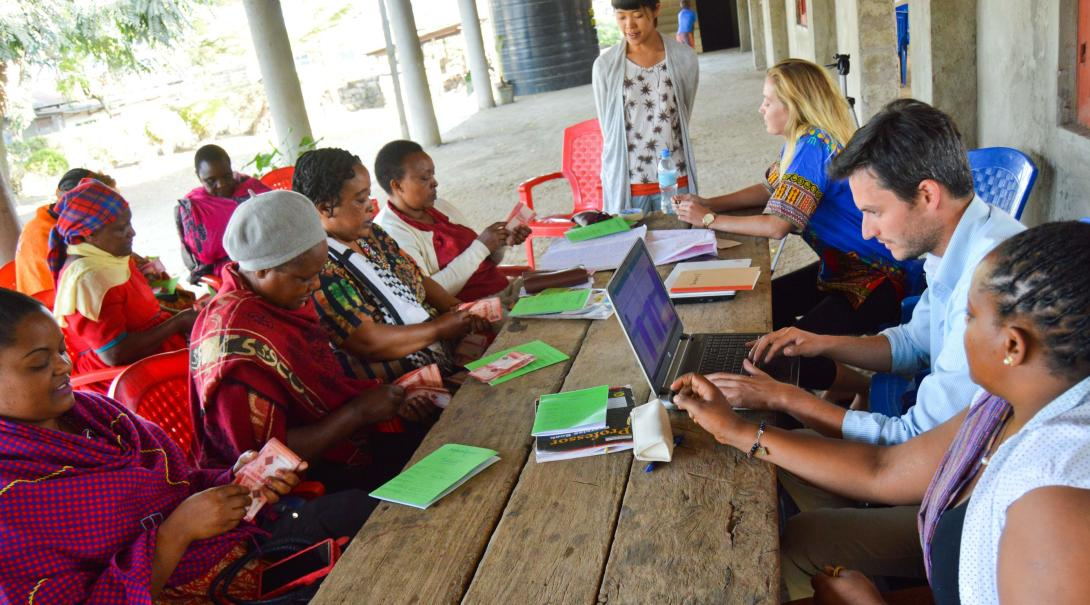 A group of local women get business advice and support from Microfinance interns in Tanzania.